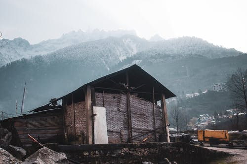 Brown Wooden House Near Mountain