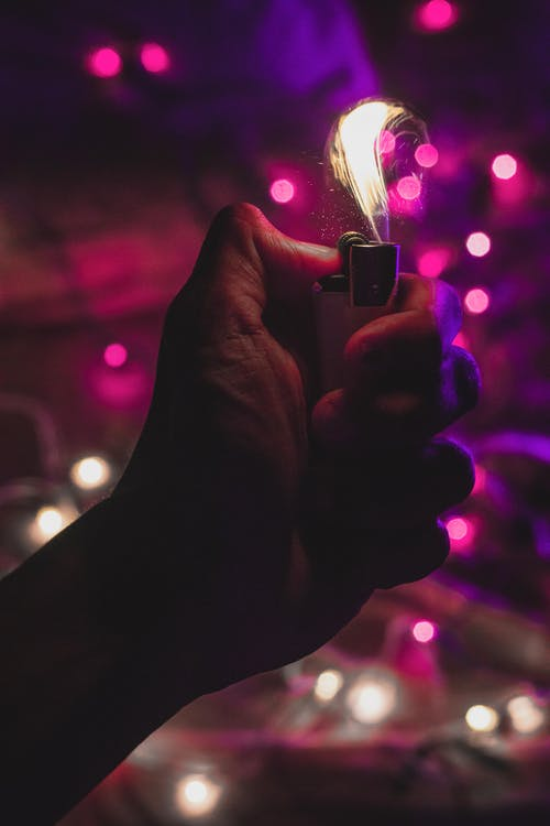 Person Holding Lighter With Red Light