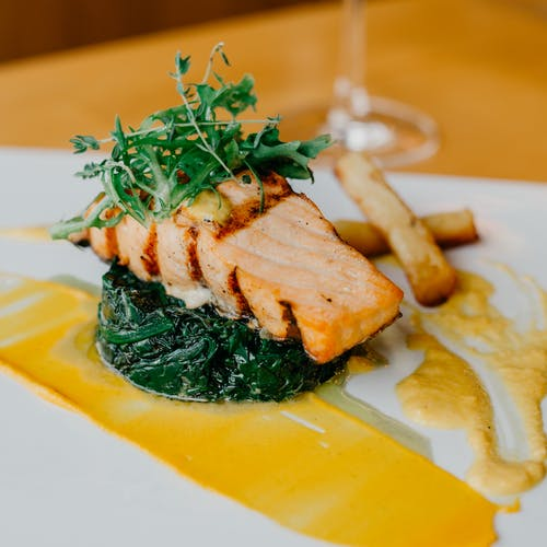 Delicious salmon steak with spinach