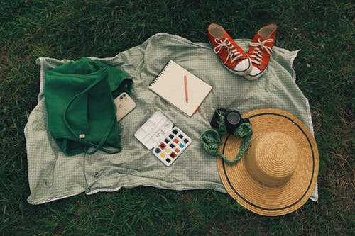 Red and White Converse All Star High Top Sneakers Beside Green and Brown Fedora Hat and