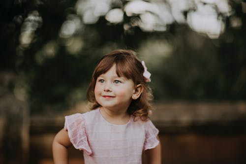 Smiling girl with gray eyes in garden