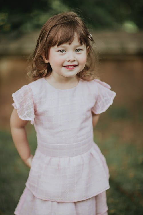 Dreamy girl in dress in summer countryside