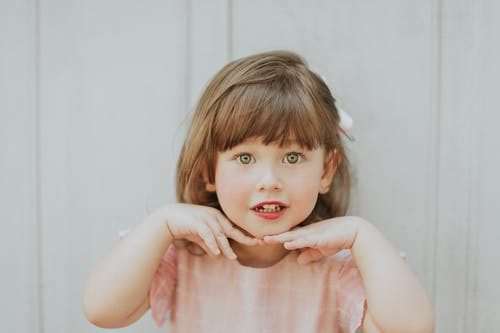 Charming girl with gray eyes and brown hair