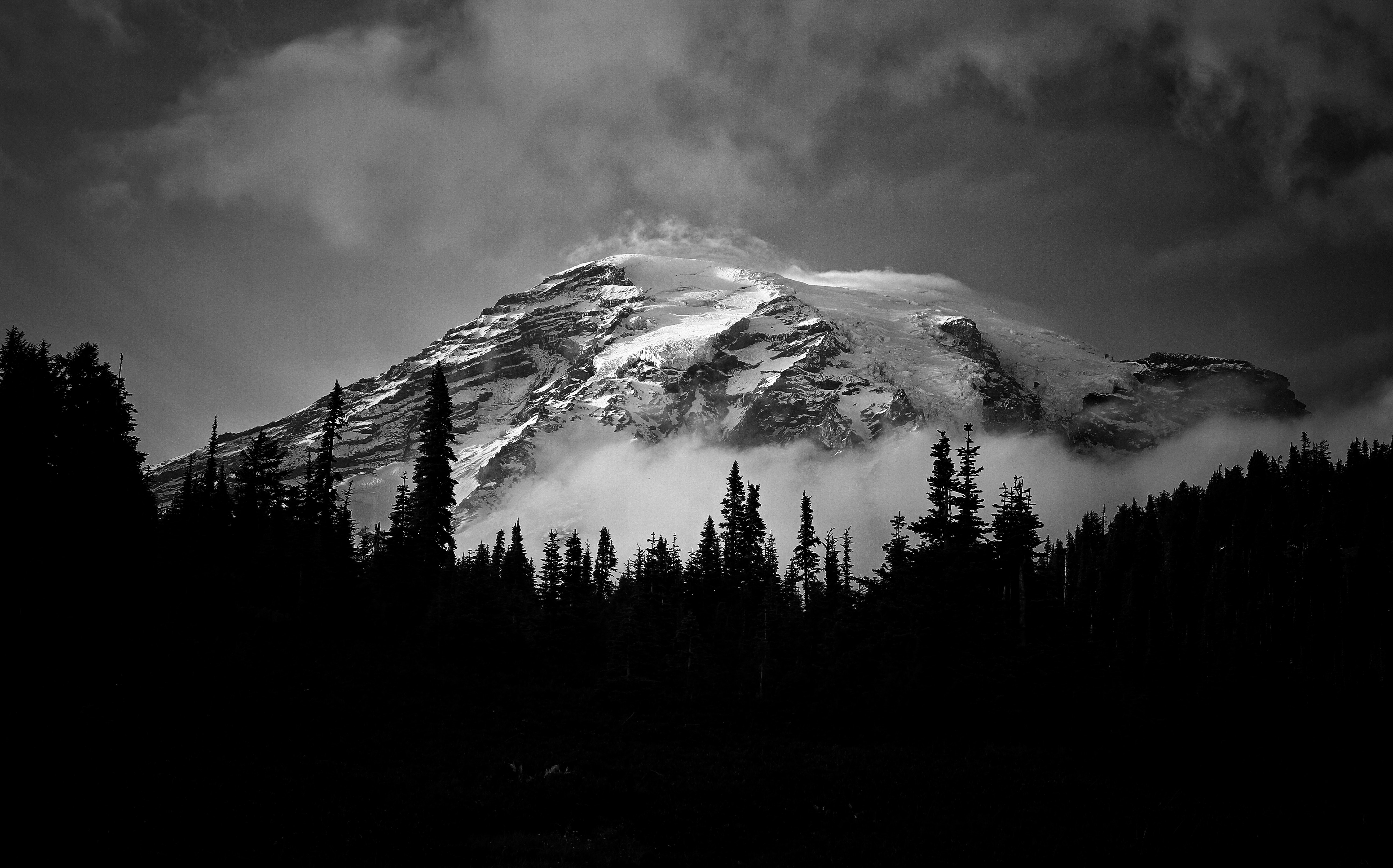 Grayscale photo of a mountain covered with snow balamurugan anbazhagan