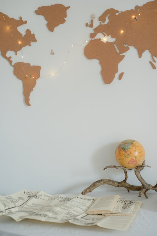 Fairy Lights Hanging Over the Map on the White Wall