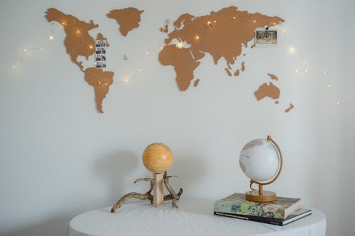 Globe Ball on the Table Covered with White Fabric