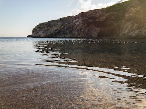 Photos gratuites de aube, bord de mer, caillou