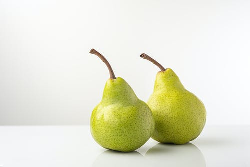 Close-Up Photo of Two Green Pears