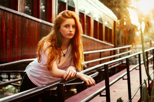 Woman in Pink Shirt Sitting on Train