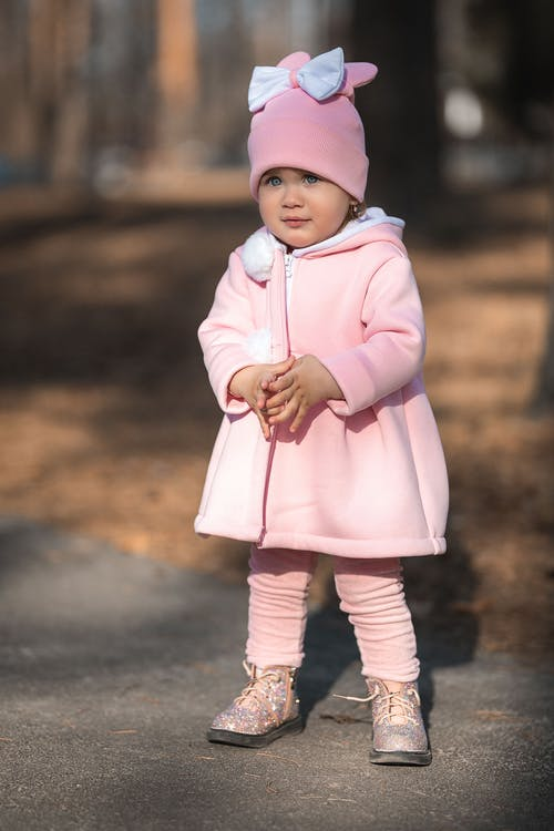A Baby Girl Wearing an All Pink Attire