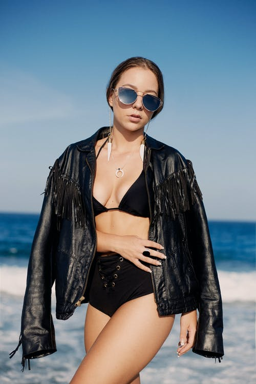 Woman in Black Leather Jacket and Black Sunglasses
