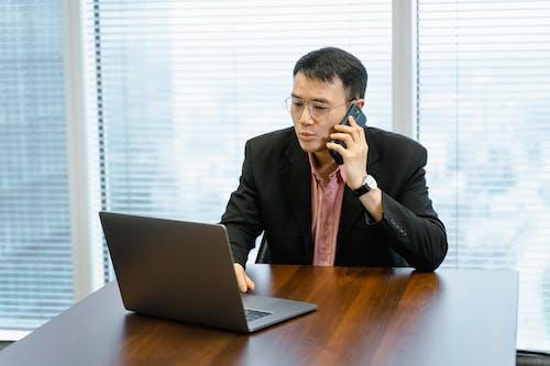 Kostenloses Stock Foto zu anruf, arbeiten, asiatischer mann