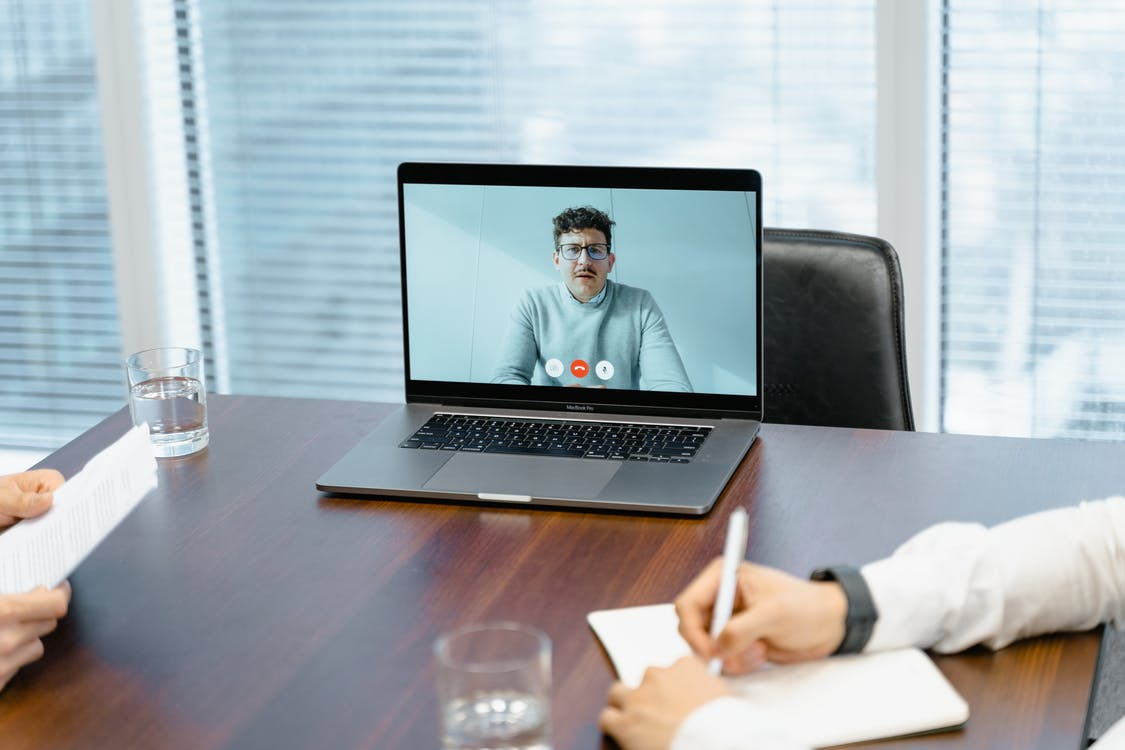 A Businessman in an Online Meeting
