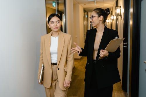 Businesswomen in a Hallway
