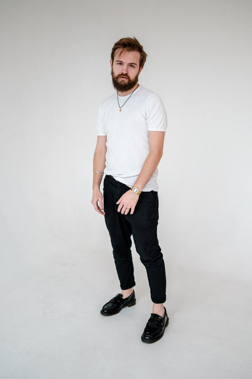Man in White Polo Shirt and Black Pants