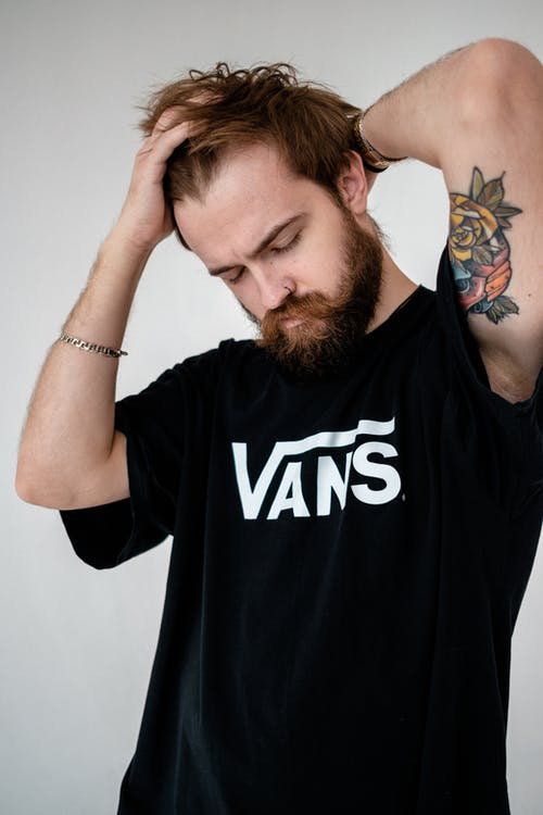 Man in Black Crew Neck T-shirt With Blue and Black Butterfly Tattoo on His Face