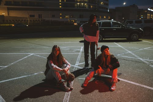 Young Women on Parking Lot