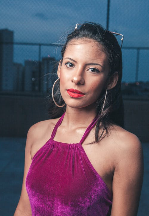 Portrait Photo of Woman in Pink Tank Top