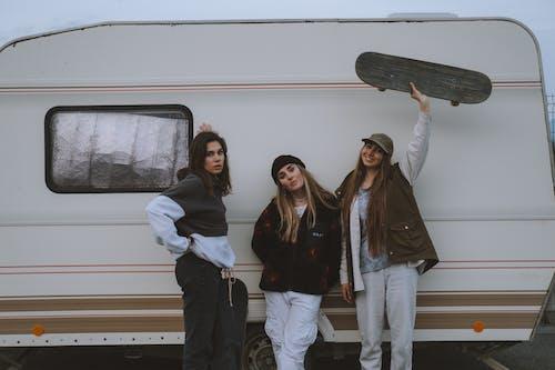 Friends Standing Beside a Caravan
