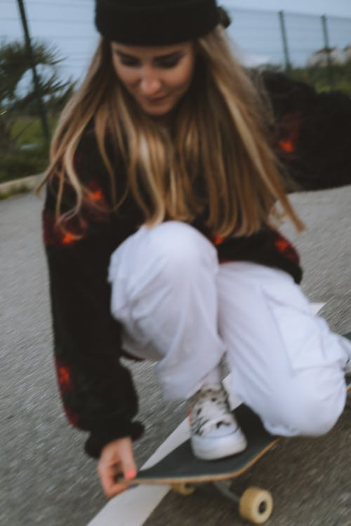 Young Woman Riding a Skateboard