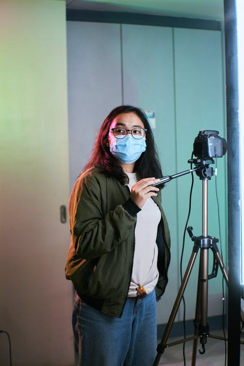 Female Photographer wearing a Face Mask