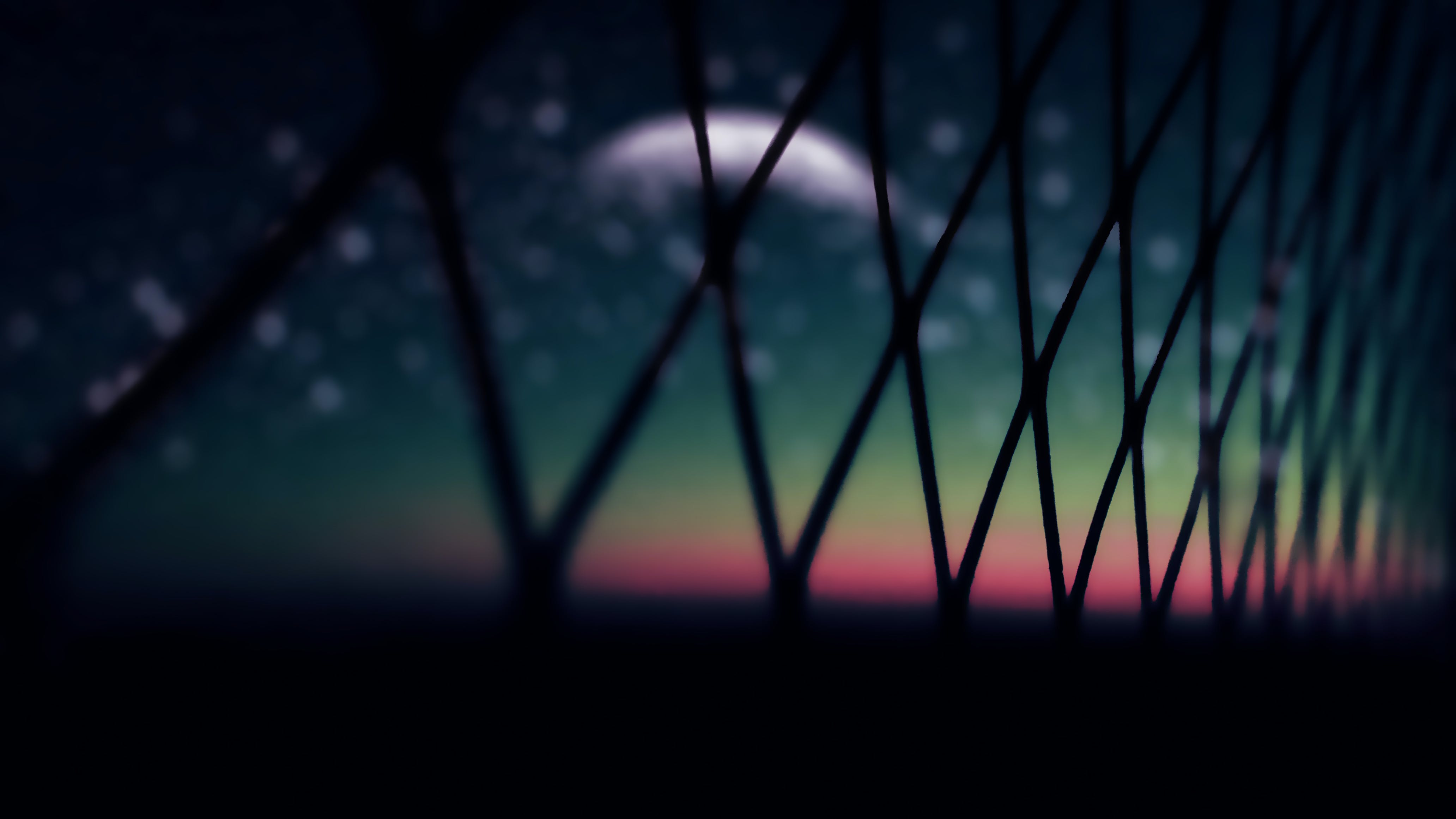 Black Link Wire Fence at Night