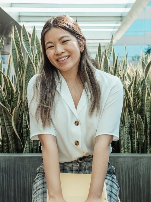 Woman in White Button Up Shirt Smiling