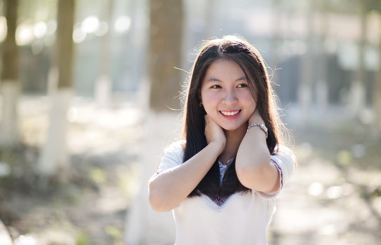 Close-Up Photography of Asian Woman Smiling