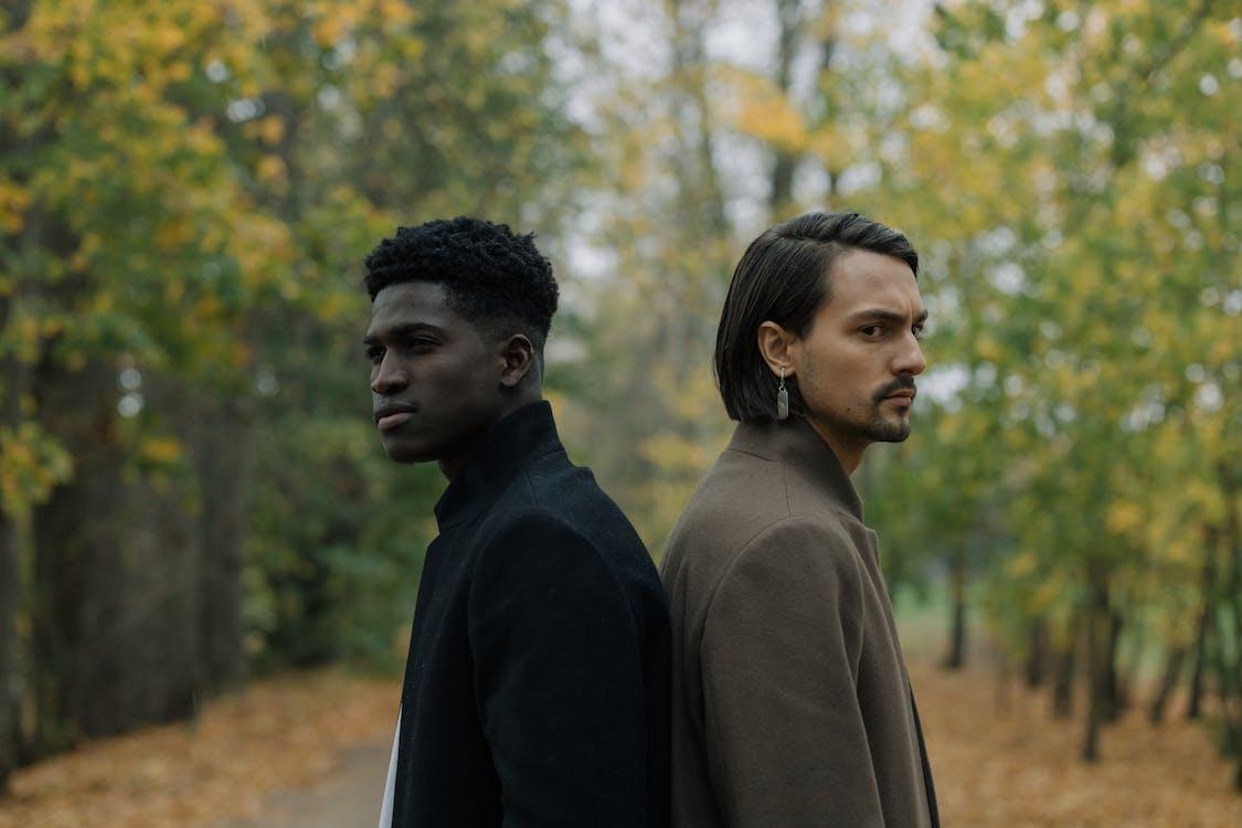 Man in Black Coat Standing Beside Woman in Brown Coat