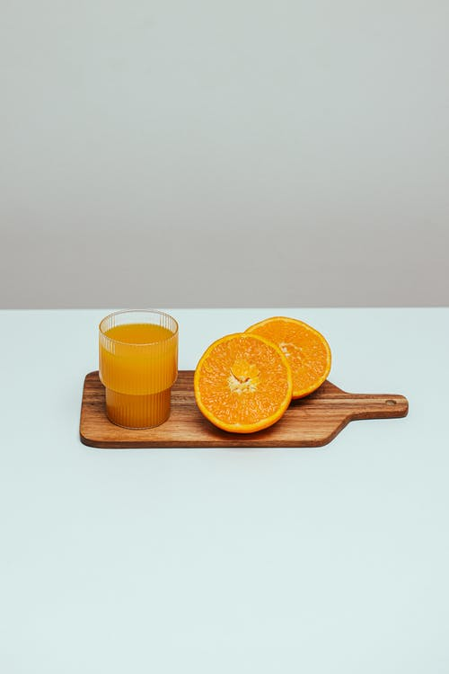 A Fresh Orange Juice on a Wooden Chopping Board