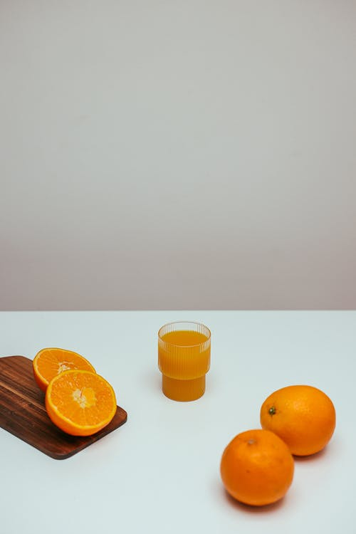 A Fresh Orange Juice on a White Table