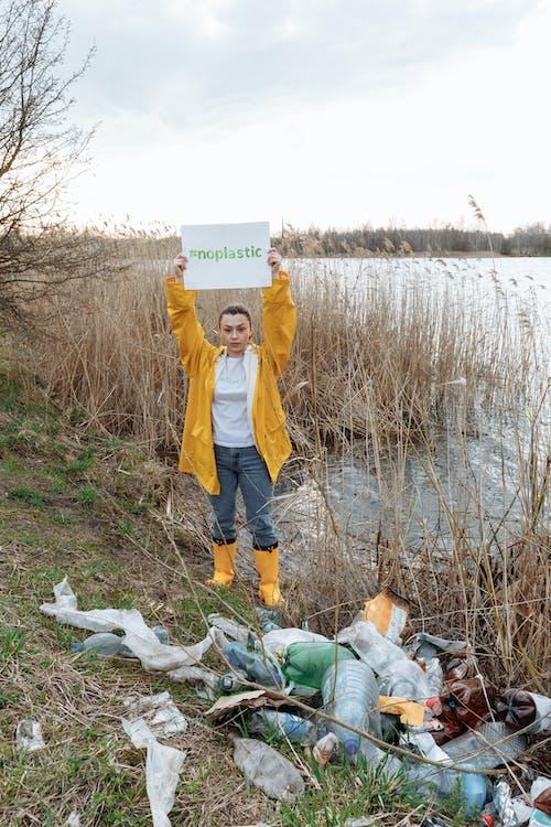 Woman Standing Beside Garbage