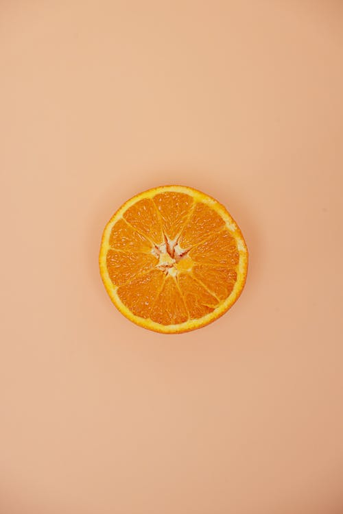 Top View of Sliced Orange Fruit on White Surface