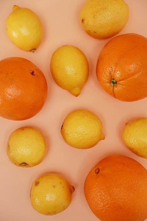 オレンジ, ピンクの背景, レモンの無料の写真素材
