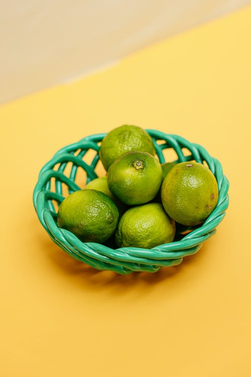 Limes on Green Round Basket