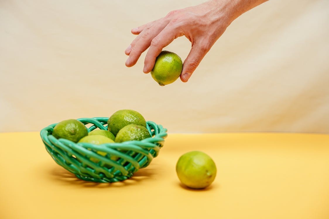 Person Holding Green Lemon