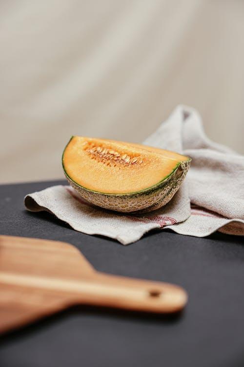 Sliced Melon on Beige Towel