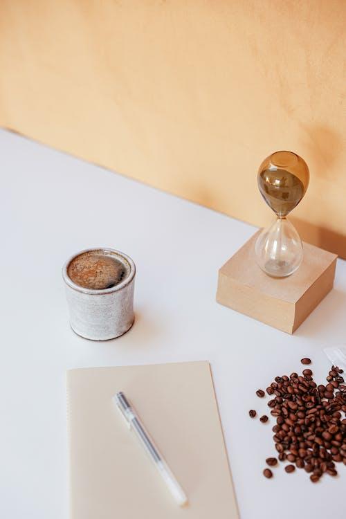 Coffee Beans beside Hourglass