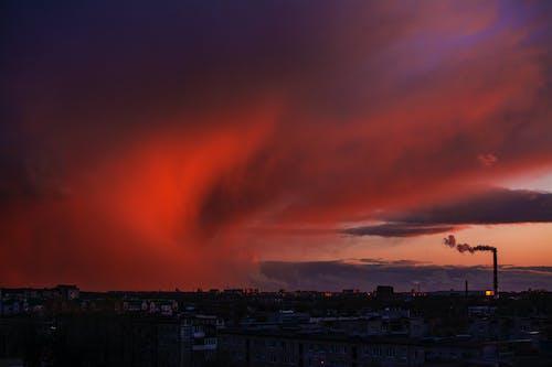 City Skyline Under Orange Clouds