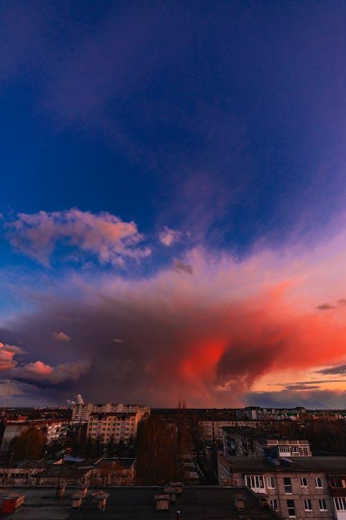 City Skyline Under Blue and Orange Sky during Sunset