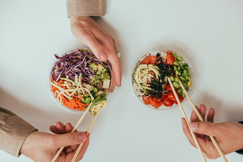 Person Holding White Ceramic Bowl With Vegetable Salad