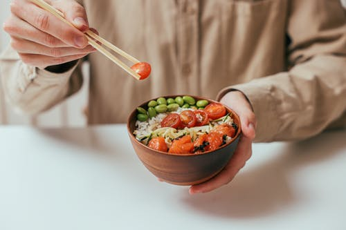 Person Holding a Vegetable Rice Bowl