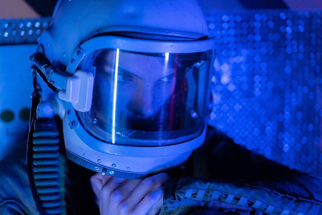 Portrait Of A Spacewoman Under Blue Light
