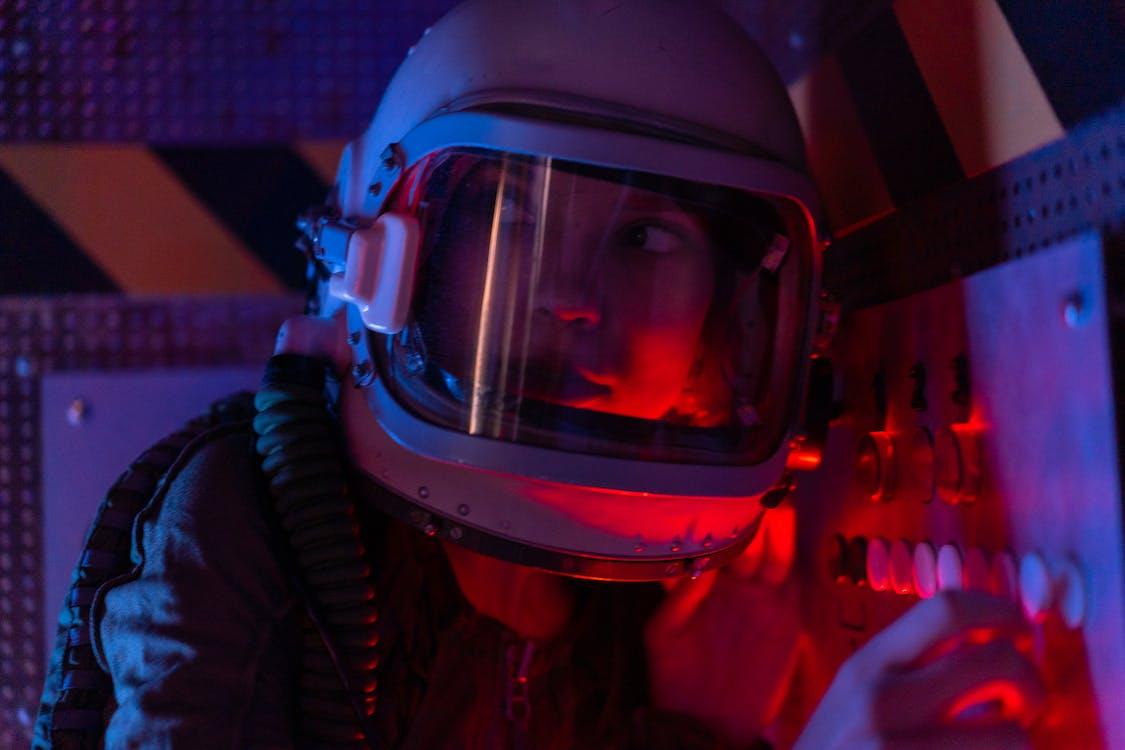 Woman In Spacesuit Looking Worried