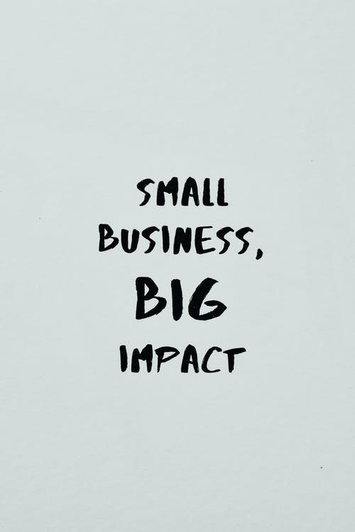 Small Business Big Impact Text on a White Surface