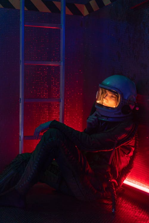 Woman In Spacesuit Sitting On Floor