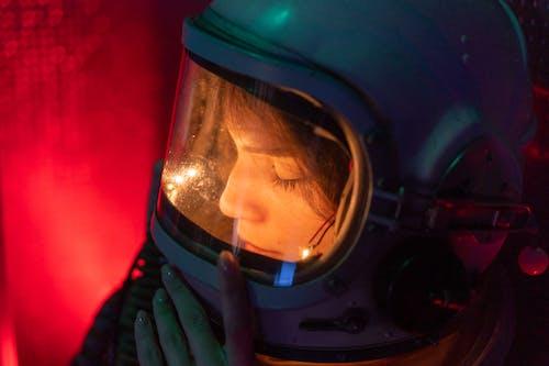 Woman In Spacesuit With Blue Helmet