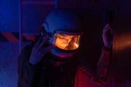 Woman In Spacesuit Looking Down