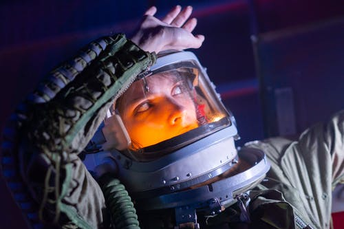 Woman In Spacesuit Looking Surprised