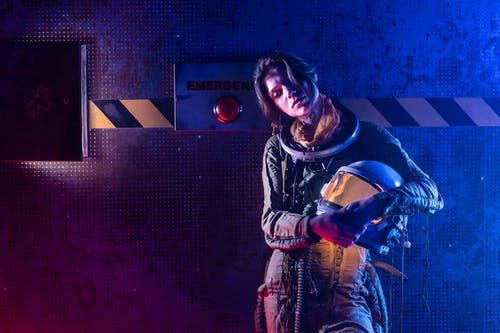 Woman in Spacesuit Looking Exhausted
